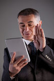 Grandfather saluting children on a tablet Stock Photo