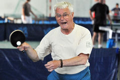 Grandfather senior plays table tennis Stock Photo
