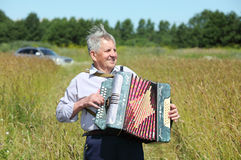 Grandfather in shirt play on accordion Stock Image