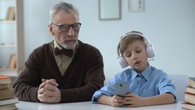 Grandfather shocked by grandson behavior, poor upbringing, disrespect for elders. Stock footage stock footage