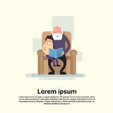Grandfather Sit With Grandson In Armchair Read Book Small Child Stock Photo