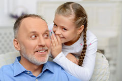 Grandfather sitting with his grandchild Stock Image