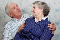 Grandfather something tells grandmother Royalty Free Stock Image