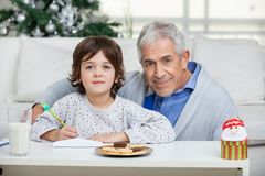 Grandfather And Son With Envelope Royalty Free Stock Image