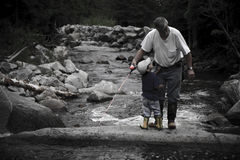 Grandfather and son fishing Royalty Free Stock Photo