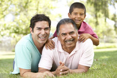 Grandfather With Son And Grandson In Park Stock Photo