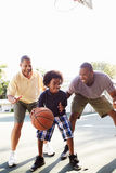 Grandfather With Son And Grandson Playing Basketball Stock Photos