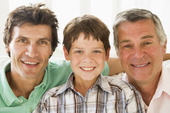 Grandfather with son and grandson smiling Royalty Free Stock Photos