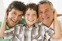 Grandfather with son and grandson smiling Stock Photos