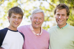 Grandfather with son and grandson smiling Royalty Free Stock Photography