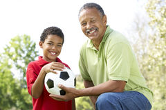 GrandFather And Son In Park With Soccer Ball. GrandfatherFather And Son In Park With Soccer Ball Smiling Royalty Free Stock Photo