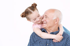 Grandfather spending time with granddaughter Stock Images