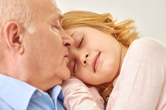 Grandfather spending time with granddaughter. Stock Photo