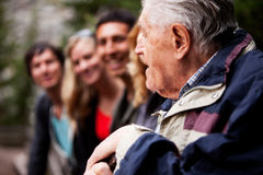 Grandfather Stories. An elderly man telling stories royalty free stock images