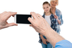 Grandfather taking photo of grandchild and grandmother Royalty Free Stock Images
