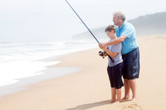 Grandfather teaching grandson fishing Royalty Free Stock Image