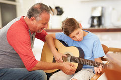 Grandfather Teaching Grandson To Play Guitar Royalty Free Stock Photography