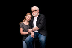 Grandfather and teenage granddaughter royalty free stock photography