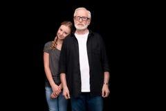 Grandfather and teenage granddaughter stock image