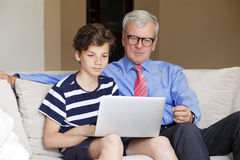Grandfather and teenager boy Royalty Free Stock Image
