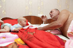 Grandfather telling story for grandson Stock Photo