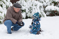 Grandfather and toddler boy  on winter day Royalty Free Stock Images