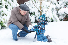 Grandfather and toddler boy  on winter day Royalty Free Stock Image