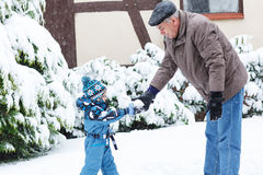 Grandfather and toddler boy  on winter day Royalty Free Stock Photos