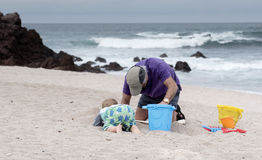 Grandfather & Toddler Grandson Play on the Beach in Mexico Stock Photos