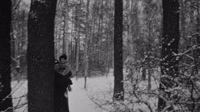 Grandfather in uniform take grandson in fur coat on hands in winter forest. Baby smile in camera. Grandfather in military uniform take little grandson in fur stock video
