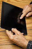 The grandfather use the tablet Stock Image