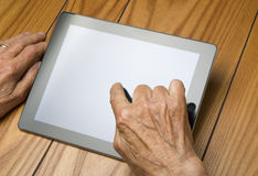 The grandfather use the tablet Royalty Free Stock Image