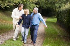 Grandfather walking with son and grandson royalty free stock photo