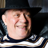 Grandfather who is proud on his new cowboy hat Stock Photography