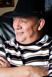 Grandfather who is proud on his new cowboy hat Stock Photos
