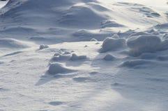 Grandi cumuli di neve e fiocchi di neve Fotografia Stock