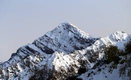 Grandi foto delle montagne nevose Fotografia Stock