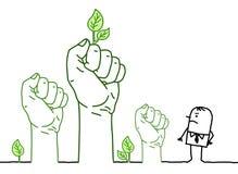 Grandi mani verdi con personaggio dei cartoni animati - protesta Immagini Stock