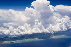 Grandi nubi dell'isola Immagine Stock