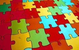 Grandi pezzi di puzzle che formano un mosaico complesso colorato Fotografia Stock Libera da Diritti