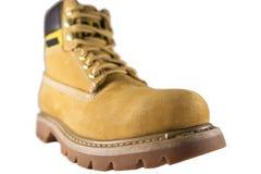 Grandi scarpe gialle con le sogliole ed i pizzi ruvidi Fotografia Stock