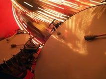 Grandi tamburi bassi con il Merry-go-round Fotografia Stock
