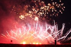 Grandiose fireworks with silhouettes of a huge crowd of people Royalty Free Stock Image