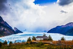 Grandiose glacier Perito Moreno. In the Argentine part of Patagonia. The concept of ecological and extreme tourism. Large observation deck for tourists royalty free stock photo