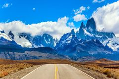 The grandiose Mount Fitz Roy. Fine highway to the grandiose Mount Fitz Roy. Argentine Patagonia. The concept of active and extreme tourism. Summer sun and blue Royalty Free Stock Photos
