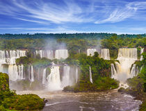 Grandiose waterfalls Iguazu. In South America, on the border of three countries: Brazil, Argentina and Paraguay. Concept of active and extreme tourism Stock Image