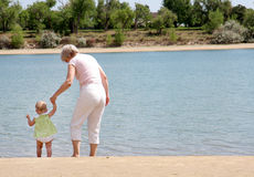 Grandma and Baby. A grandma and her grand-daughter on the beach stock images