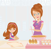 Grandma baking cookies with her granddaughter Royalty Free Stock Photography