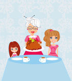 Grandma bringing thanksgiving turkey to the dinner table Royalty Free Stock Photos