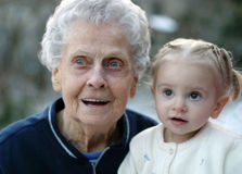 Grandma and Child. Toddler and her great great grandmother share a moment of wonder Royalty Free Stock Image